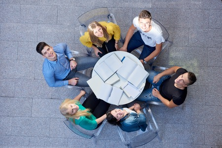 people together: top view,  group of students together  at school table working homework and have fun