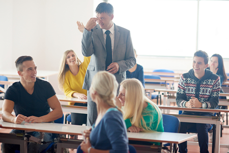 school class: group of students with teacher on class learning lessons Stock Photo