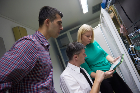 cloud technology: business people group, network engeneers working in network server room on tablet computer