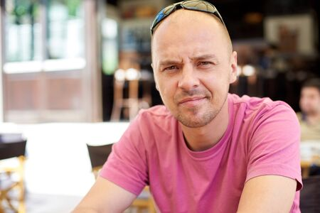 portrait man: portrait of young man on coffee break at restaurant