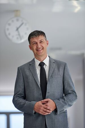 businessman suit: portrait of middle aged business man at modern office space indoors
