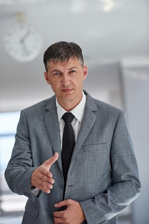 office space: portrait of middle aged business man at modern office space indoors