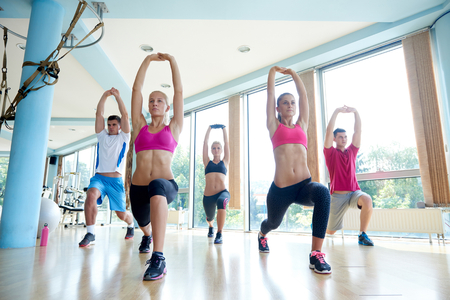 zumba: group of young people working out in a fitness gym