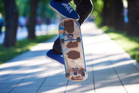skateboarding tricks: urban scene, closeup of skateboard jump Stock Photo