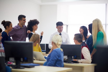 professors: group of students with teacher in computer lab classrom learrning lessons,  get help and support