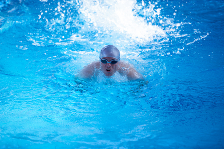excercise: swimmer excercise on indoor swimming pool, sport and health concept Stock Photo
