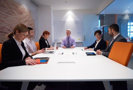 old business man: business people group with young adults and senior on meeting at modern bright office interior. Stock Photo