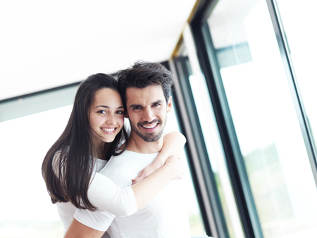livingroom: happy young romantic couple have fun relax smile at modern home livingroom indoors Stock Photo