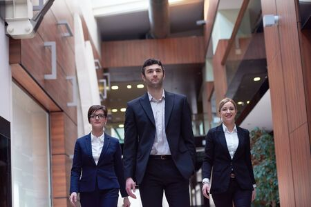 personas en la calle: young business people team walking, group of people on modern office hall interior