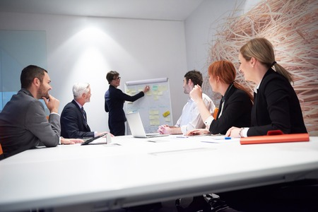 people office: business people group with young adults and senior on meeting at modern bright office interior. Stock Photo