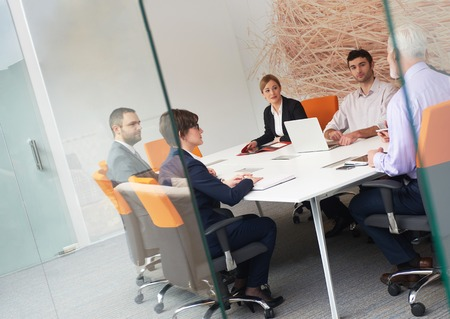 modern office: business people group with young adults and senior on meeting at modern bright office interior. Stock Photo