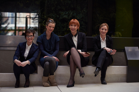 woman business suit: young business people group have meeting and working in modern bright office indoor