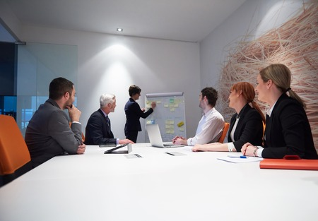 office meeting: business people group with young adults and senior on meeting at modern bright office interior. Stock Photo