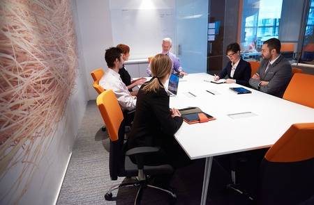 caucasian: business people group with young adults and senior on meeting at modern bright office interior. Stock Photo