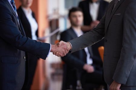 negotiation business: business partners, partnership concept with two businessman handshake Stock Photo