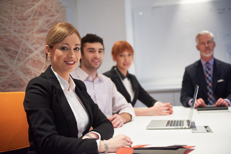 young executive: business people group with young adults and senior on meeting at modern bright office interior. Stock Photo