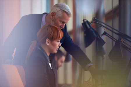 team leadership: business people group with young adults and senior on meeting at modern bright office interior. Stock Photo