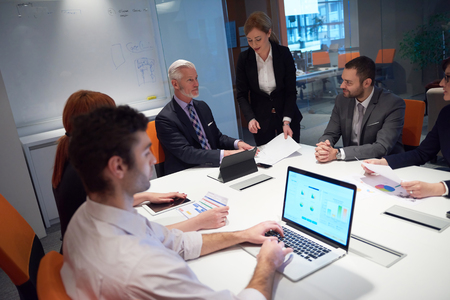 group meeting: business people group with young adults and senior on meeting at modern bright office interior. Stock Photo