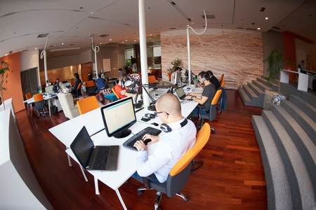 business software: startup business people group working everyday job  at modern office