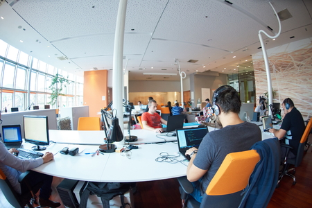 the programmer: startup business people group working everyday job  at modern office