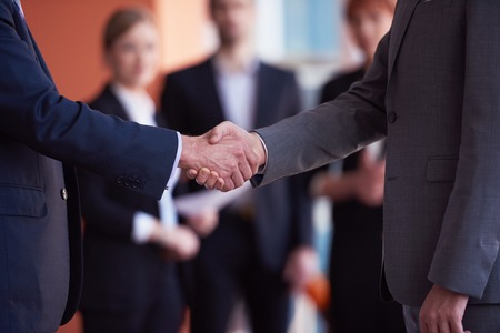 partnership: business partners, partnership concept with two businessman handshake Stock Photo