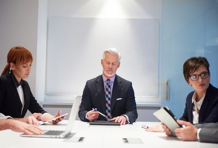 manager team: business people group with young adults and senior on meeting at modern bright office interior. Stock Photo