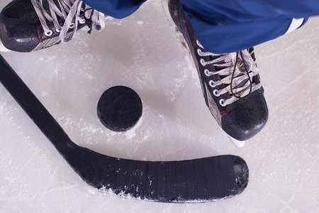 business game: two hockey sticsk and puck on ice, start of the game, competition concept in business, top view Stock Photo