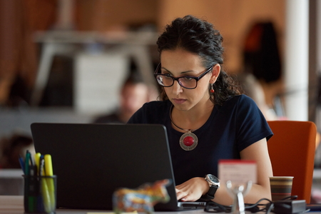 girl with laptop: startup business, woman  working on laptop computer at modern office Stock Photo