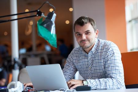 programming: startup business, software developer working on computer at modern office