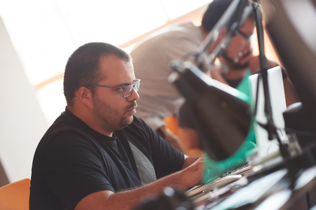 program: startup business, software developer working on computer at modern office