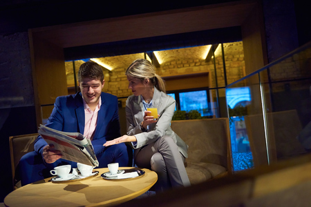 break from work: young business people couple relaxing after work in bar restaurant and take drink