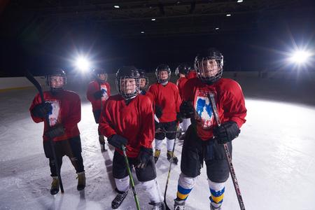 child sport: happy children group  ice hockey team  sport players portrait