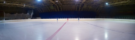 hockey puck: empty ice rink, hockey and skating arena  indoors