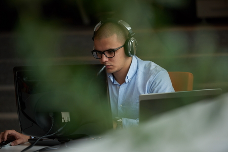 software company: startup business, software developer working on computer at modern office