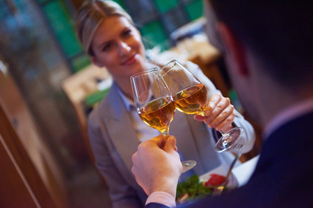 business dinner: business people meeting in modern restaurant, romantic couple having dinner and take drink after work Stock Photo