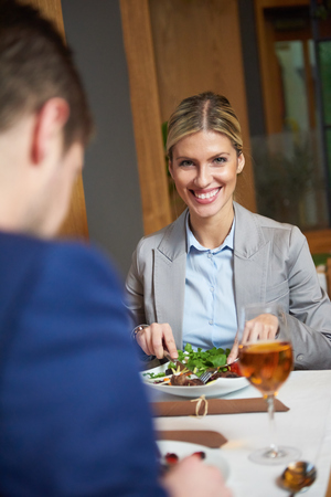 restaurant dining: business people meeting in modern restaurant, romantic couple having dinner and take drink after work Stock Photo