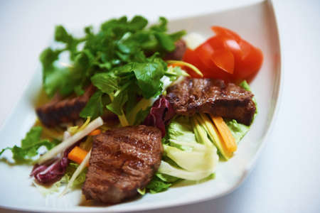 meat food: tasty bbq meat food, juicy beef steak with grilled cheese and salad in restaurant