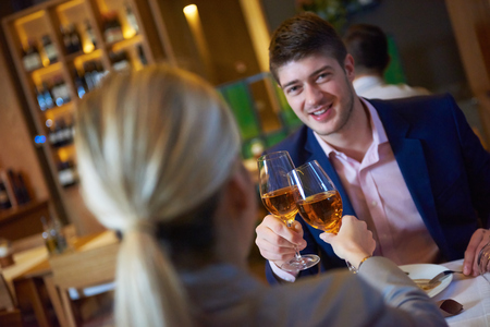 drinks on bar: business people meeting in modern restaurant, romantic couple having dinner and take drink after work Stock Photo