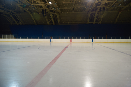 ice surface: empty ice rink, hockey and skating arena  indoors