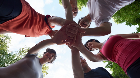 old women: jogging people group, friends have fun,  hug and stack hands together after training