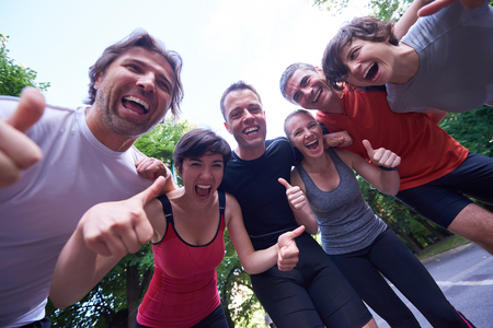 healthy men: jogging people group, friends have fun,  hug and stack hands together after training