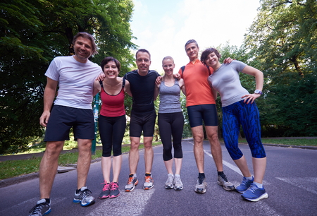 outdoor fitness: people group jogging, runners team on morning  training