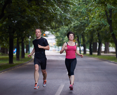outdoor fitness: urban sports healthy couple jogging