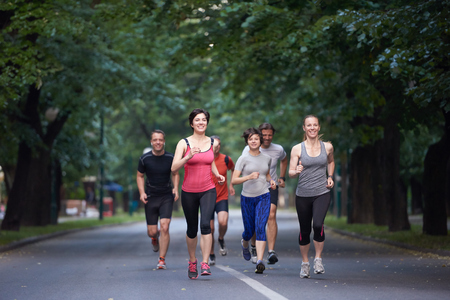 girl friends: people group jogging, runners team on morning  training