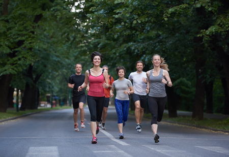 outdoor training: people group jogging, runners team on morning  training