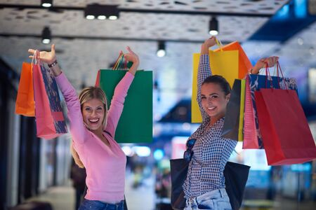 happy shopping: happy young girls in  shopping mall, friends having fun together