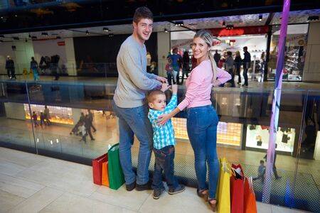 woman shop: happy  young family with shopping bags in mall