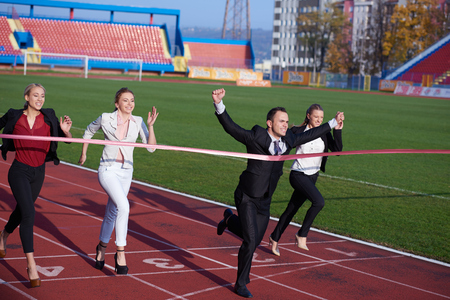 competing: business people running together on  athletics racing track Stock Photo