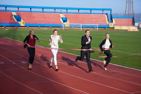 contender: business people running together on  athletics racing track Stock Photo