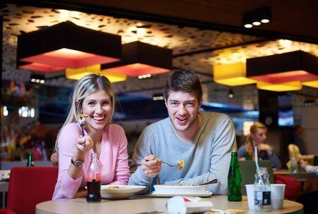 break in: couple having lunch break in shopping mall food corner